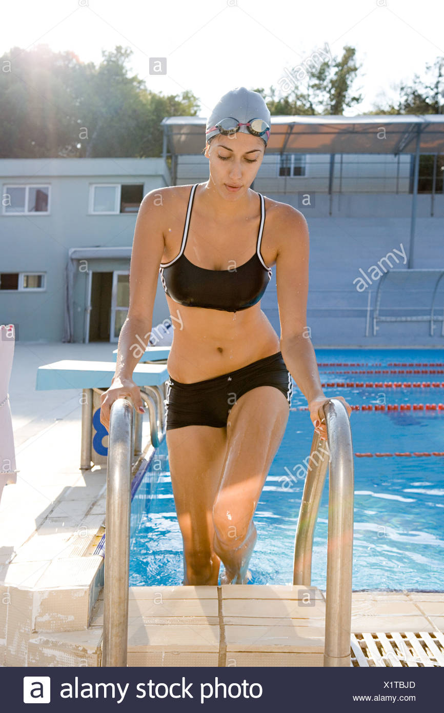 Woman emerging from pool - Stock Image
