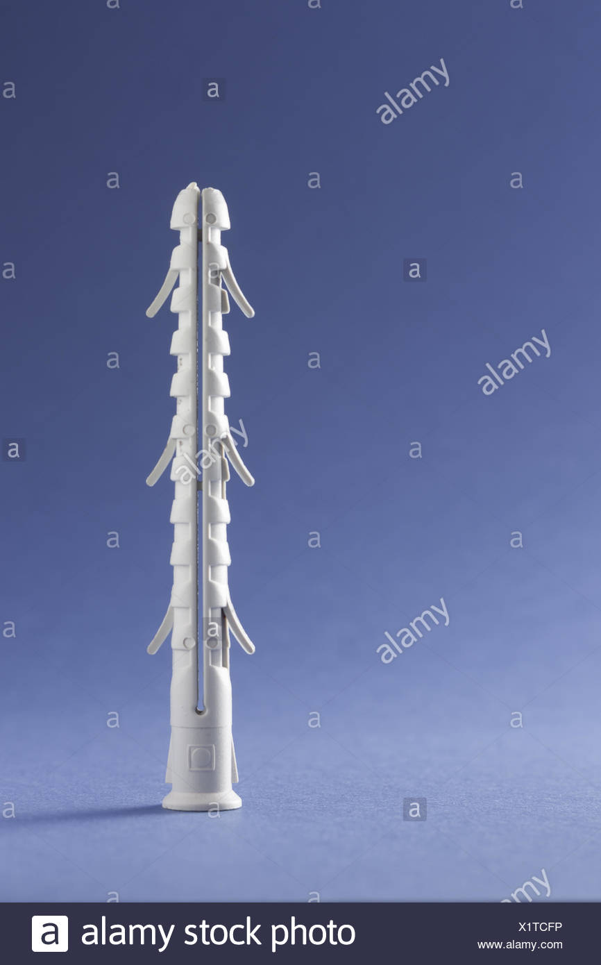 Plastic Straddling Dowel On blue Background - Stock Image