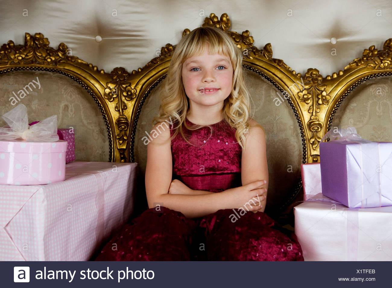 Little girl with birthday presents - Stock Image