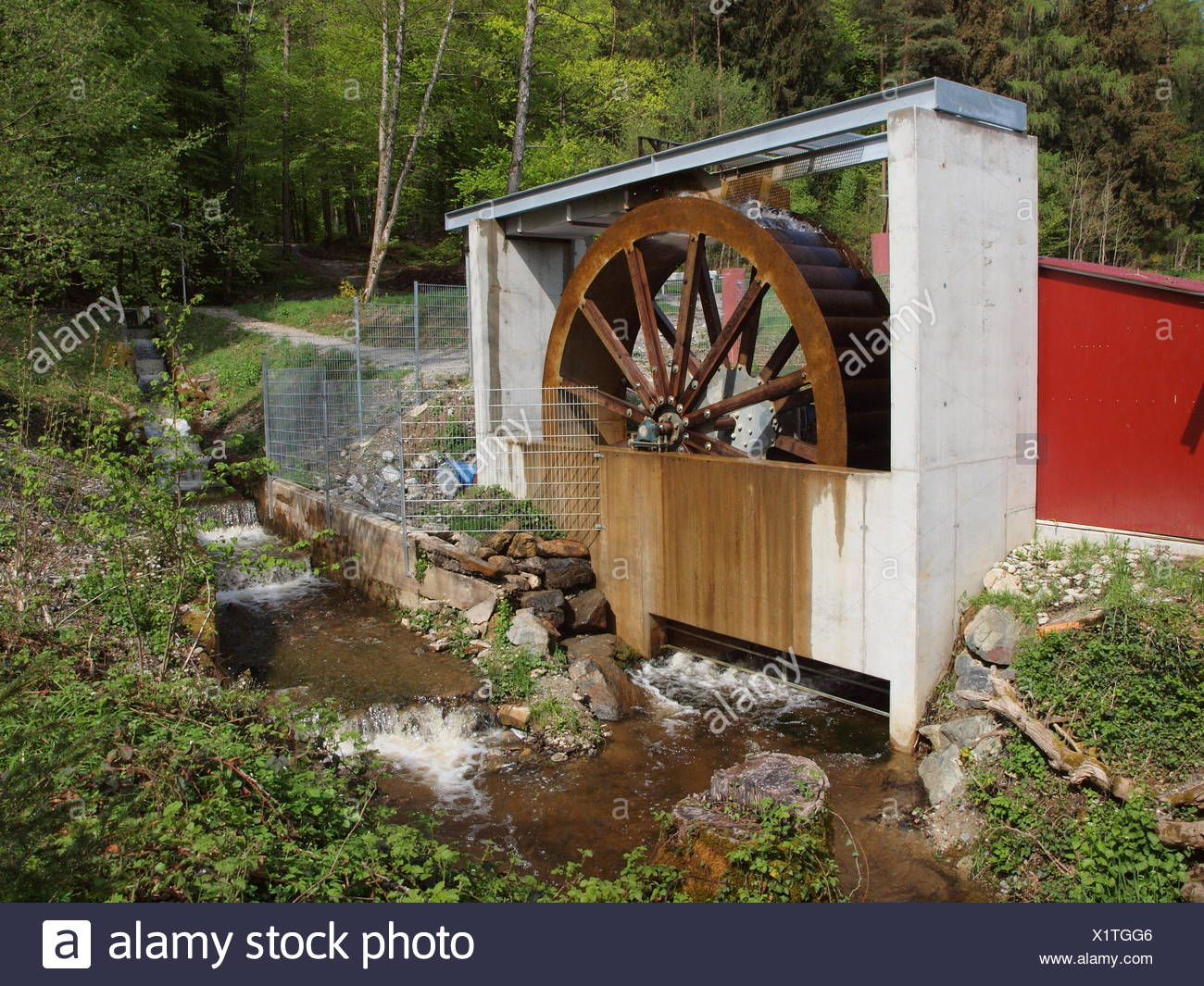 Modern waterwheel to produce electricity - Stock Image
