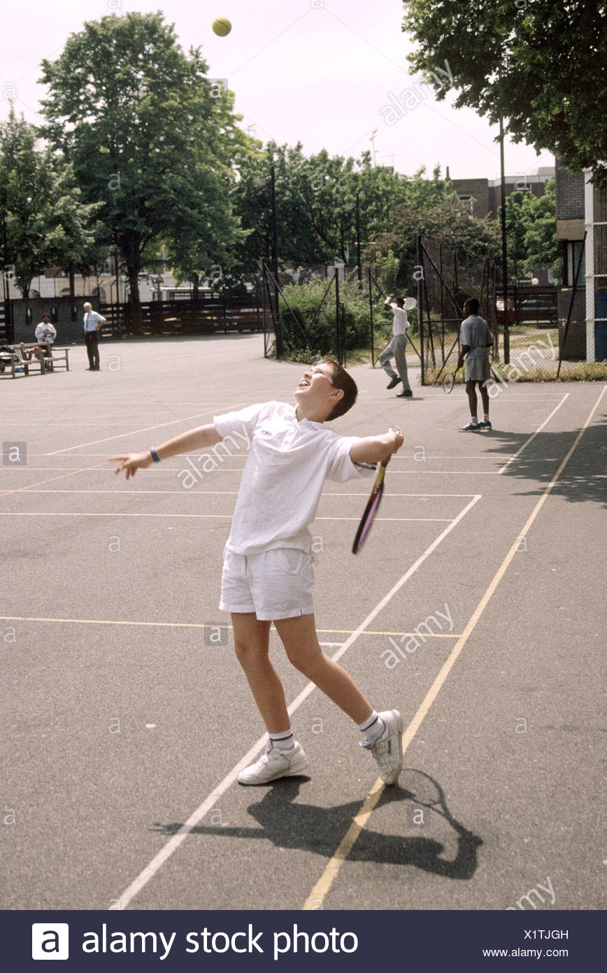secondary school tennis lesson - Stock Image
