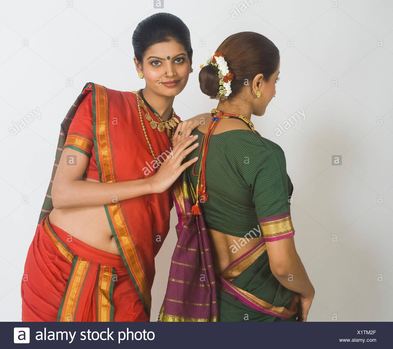 Portrait of a woman standing with her friend - Stock Image
