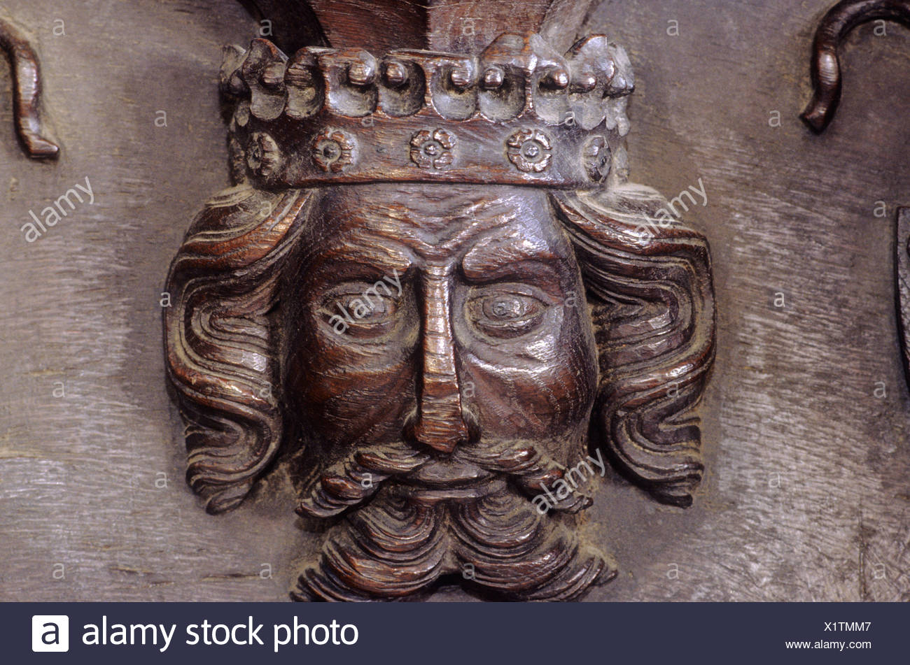 Misericord Edward the Black Prince Kings Lynn St Margaret's church 14th century English medieval wood carving head crown seat - Stock Image