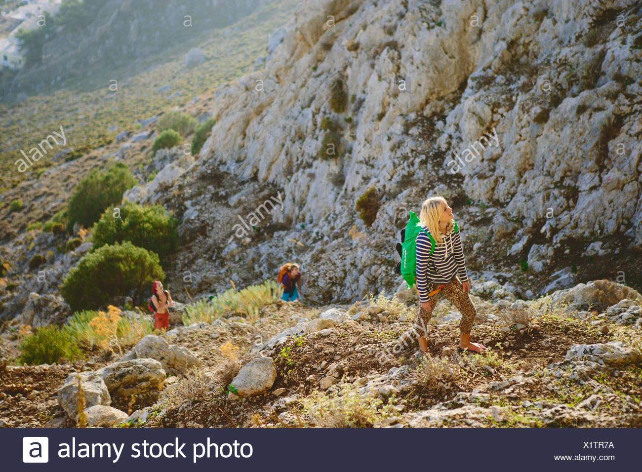 Greece, Dodecanese, Kalymnos, Young woman exploring mountains - Stock Image