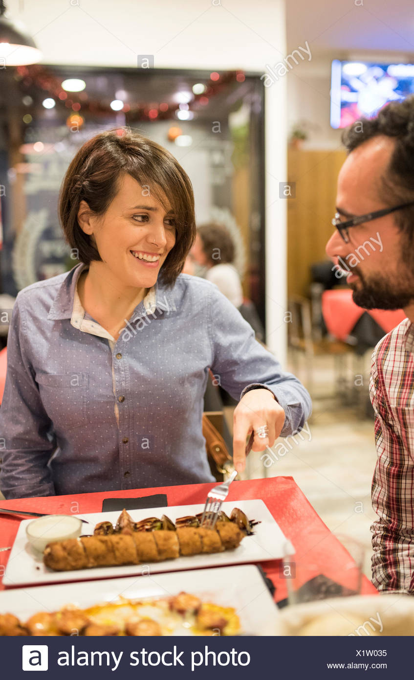 Couple eating in a Spanish bar - Stock Image