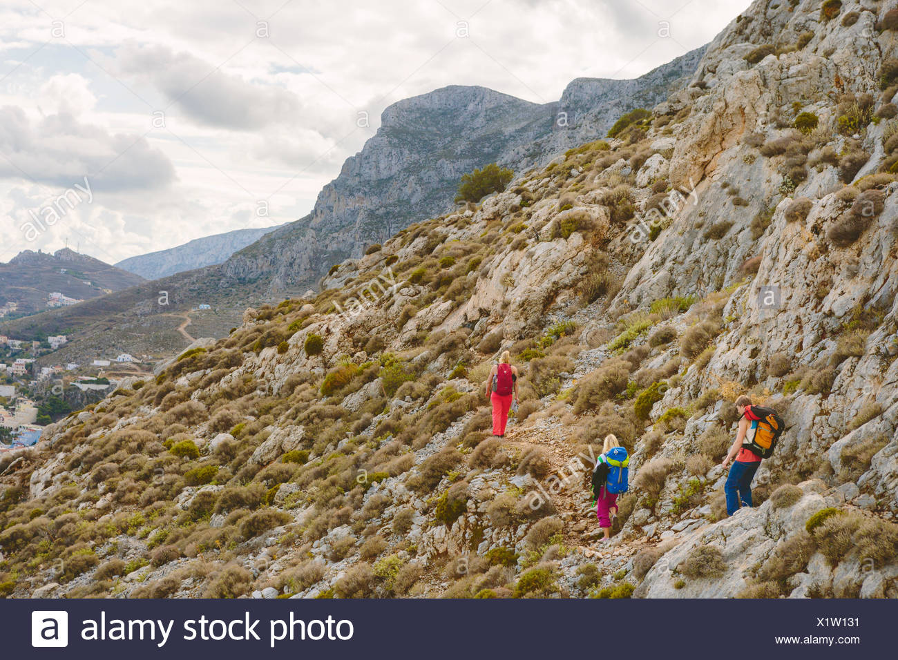 Greece, Dodecanese, Kalymnos, Hikers on mountainside - Stock Image