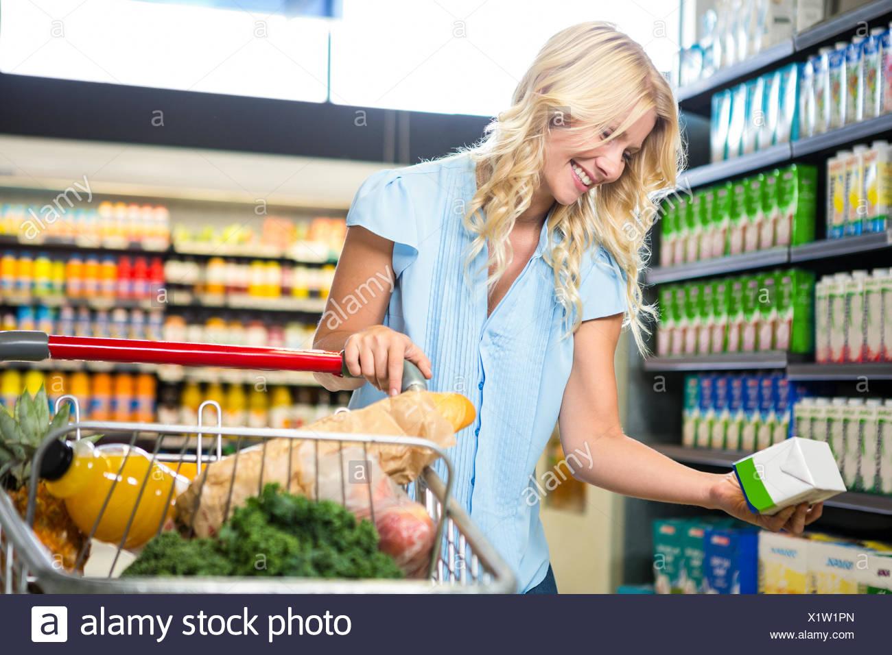 Beautiful woman holding product Stock Photo