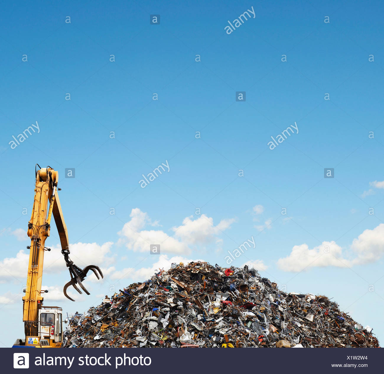 Mechanical grabber and scrap heap - Stock Image