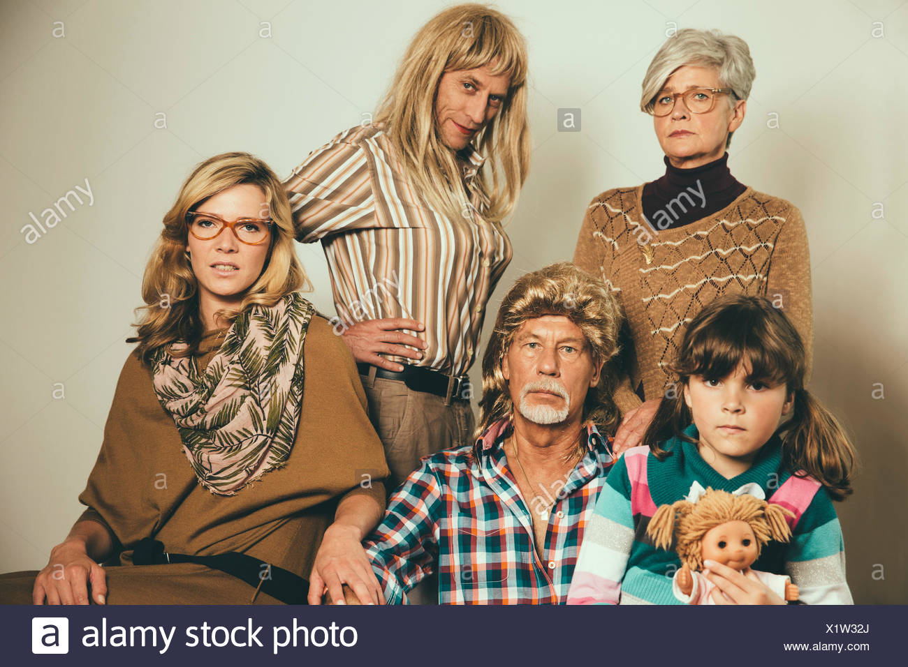 Portrait of family dressed like in the Eighties - Stock Image