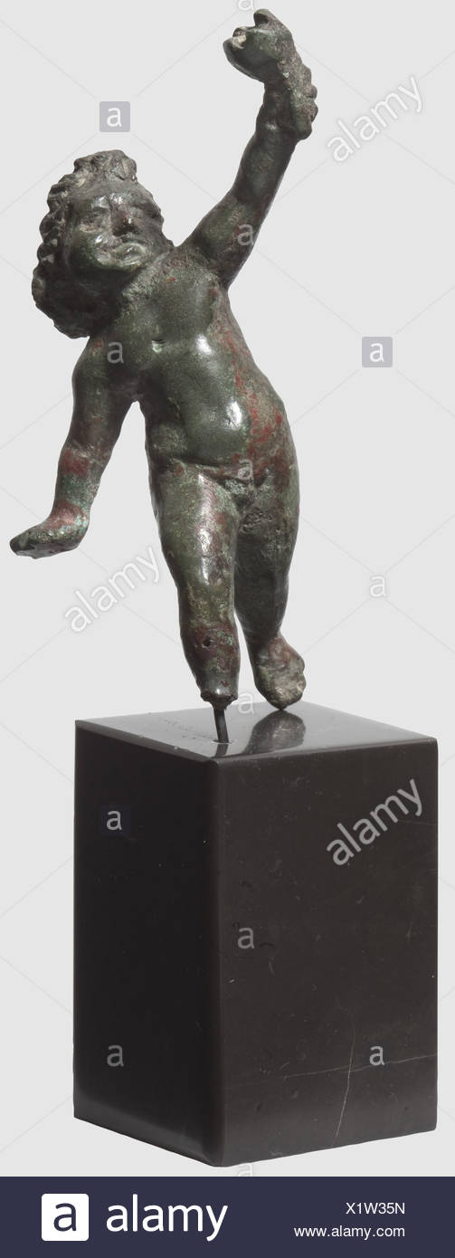 A Roman amor with torch, 1st - 2nd century AD. Bronze with greenish and brownish patina. Fully sculptured figure with wings. Upraised right arm with a torch in the right hand. The right wing and left foot missing. Mounted on a stone base. Height 6.3 cm, historic, historical, ancient world, ancient world, ancient times, object, objects, stills, clipping, cut out, cut-out, cut-outs, sculpture, sculptures, statuette, figurine, figurines, statuettes, fine arts, art, Additional-Rights-Clearences-NA - Stock Image