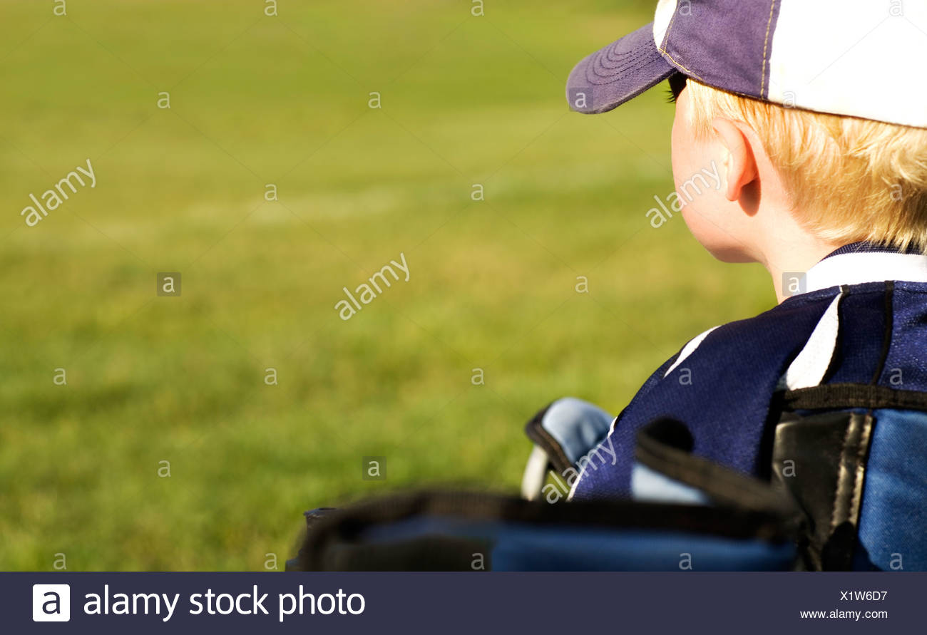 Boy wearing baseball cap - Stock Image