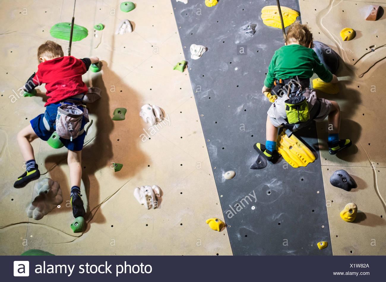 Finland, Helsinki, Boys climbing on wall - Stock Image