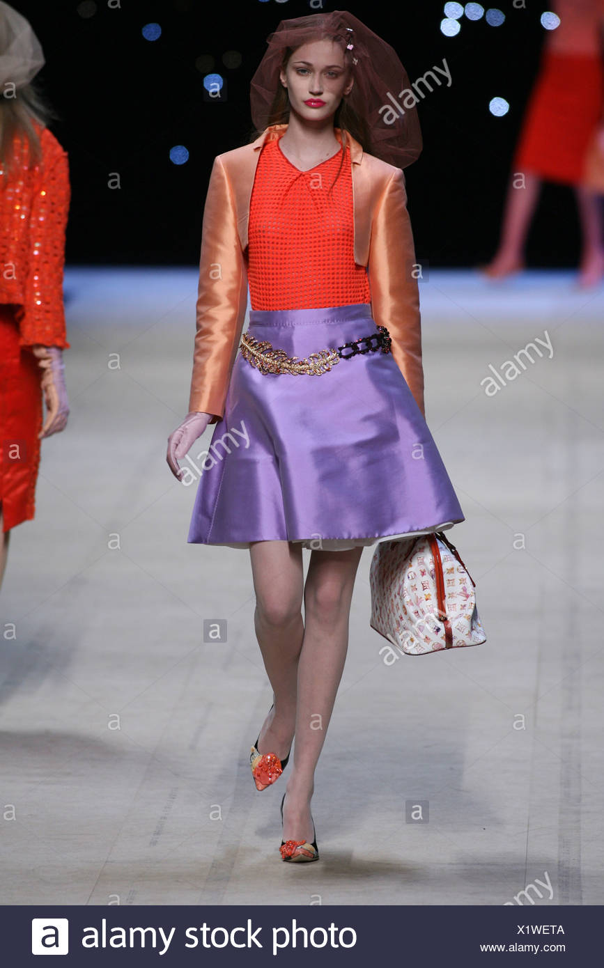db1e098487 Orange cropped taffeta jacket over red top and purple skirt, look  accessorized veil headwear, LV handbag, chain belt and gloves
