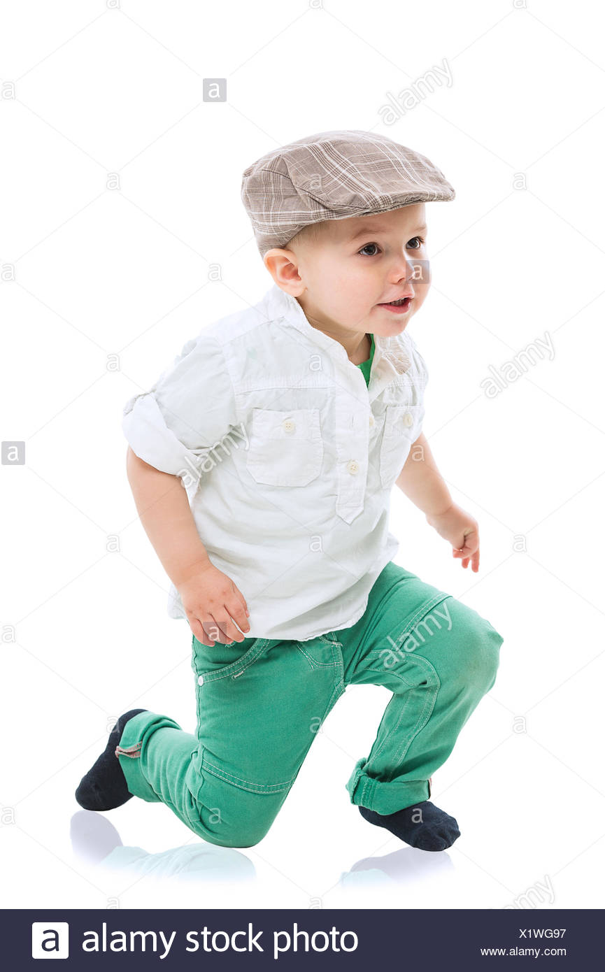 Dapper little boy in a cute outfit - Stock Image