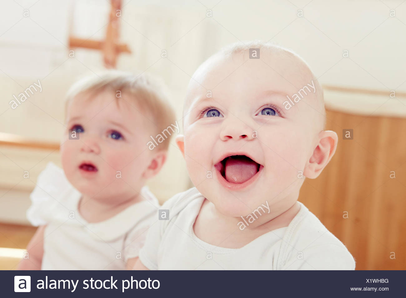 Smiling baby boy with baby girl - Stock Image