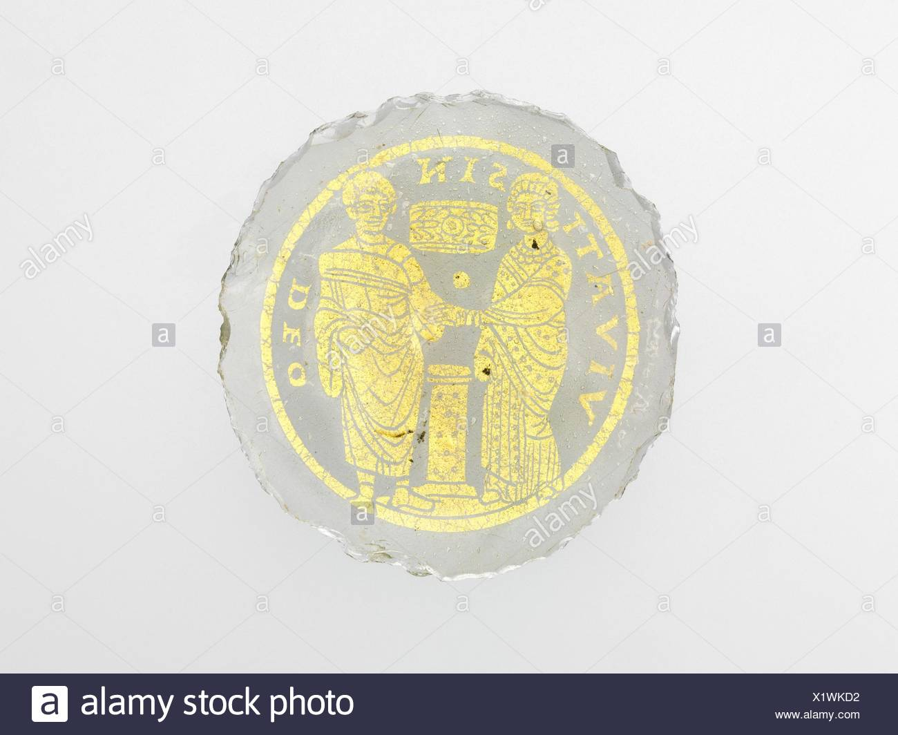 Bowl Base with a Marriage Scene. Date: 4th-5th century; Culture: Roman or Byzantine; Medium: Glass, gold leaf; Dimensions: Overall: 3 5/16 x 3/16 in. - Stock Image