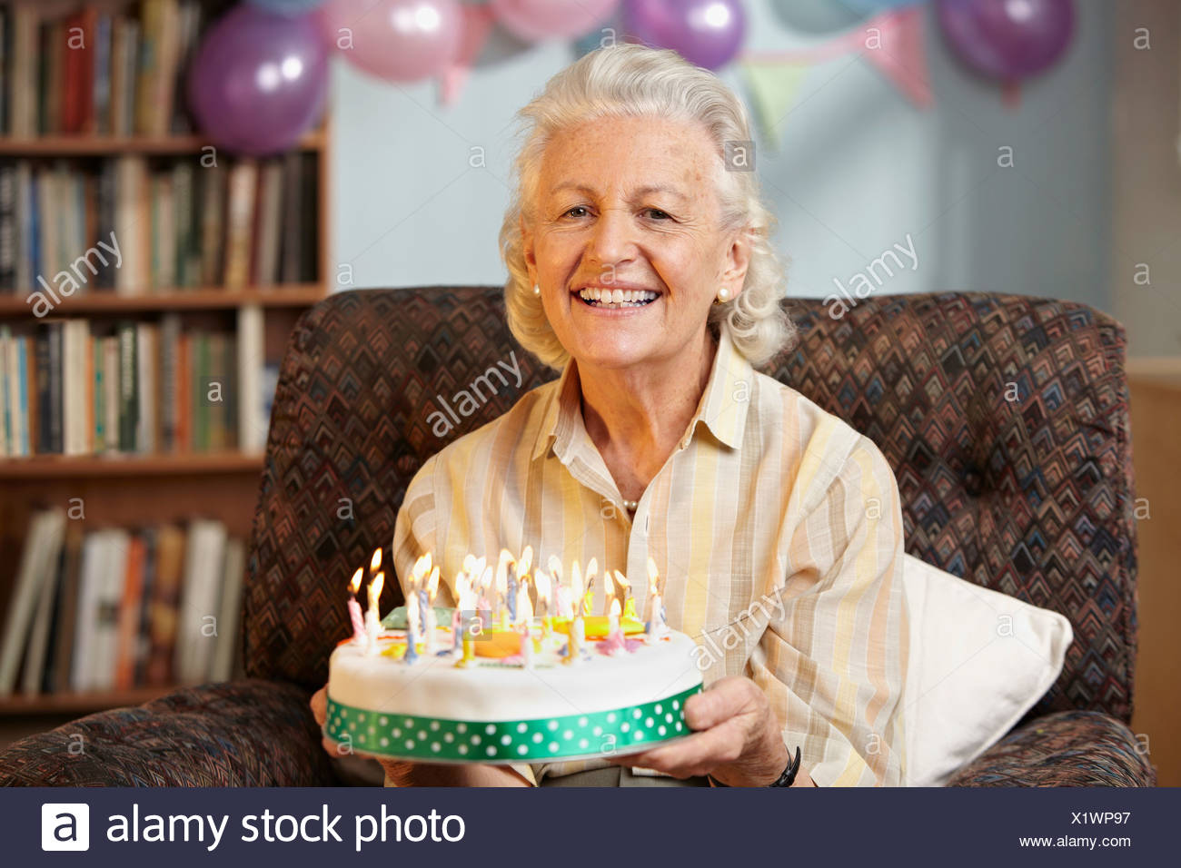 Awesome Senior Woman Holding Birthday Cake Portrait Stock Photo Birthday Cards Printable Benkemecafe Filternl