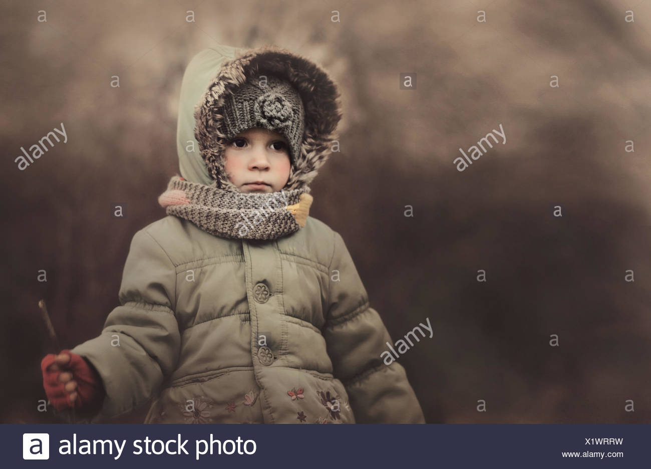 Poland, Portrait of girl wearing warm clothes - Stock Image