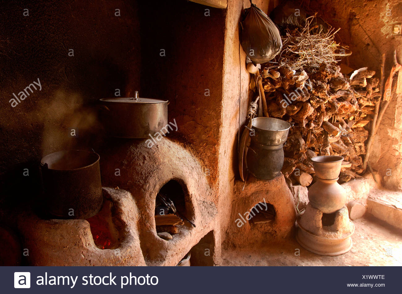 Berber house home inside equipment institution kitchen cuisine loam pots cooking boiling wood firewood F - Stock Image