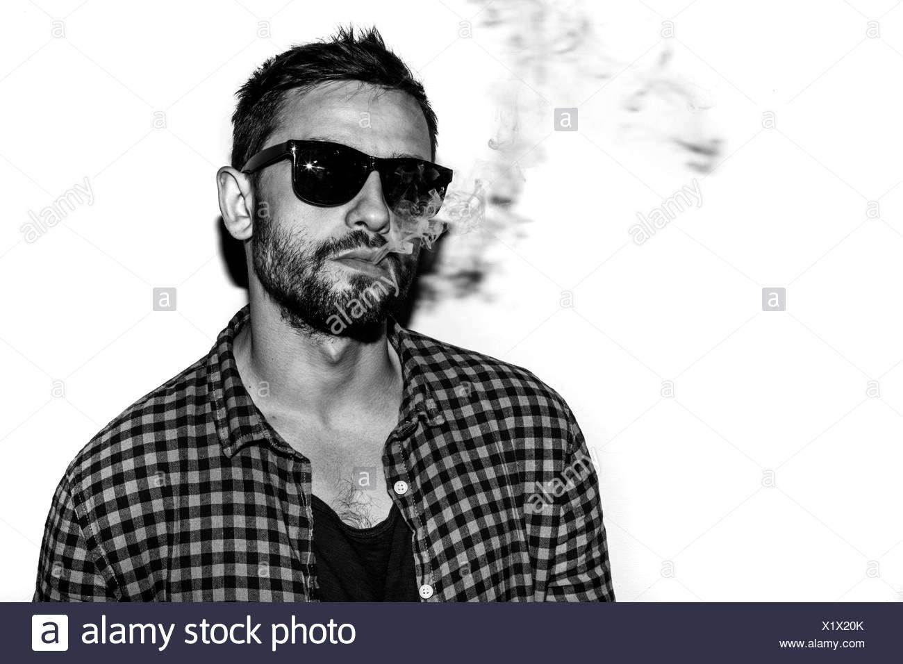 man smoking cigarette black and white portrait - Stock Image