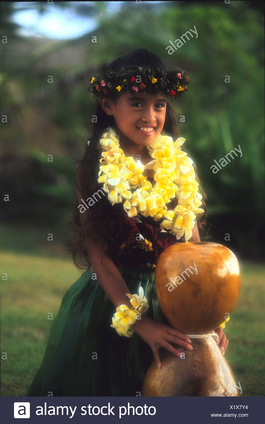 Young hula dancer (Korie Ann) with an Ipu Heke - Stock Image