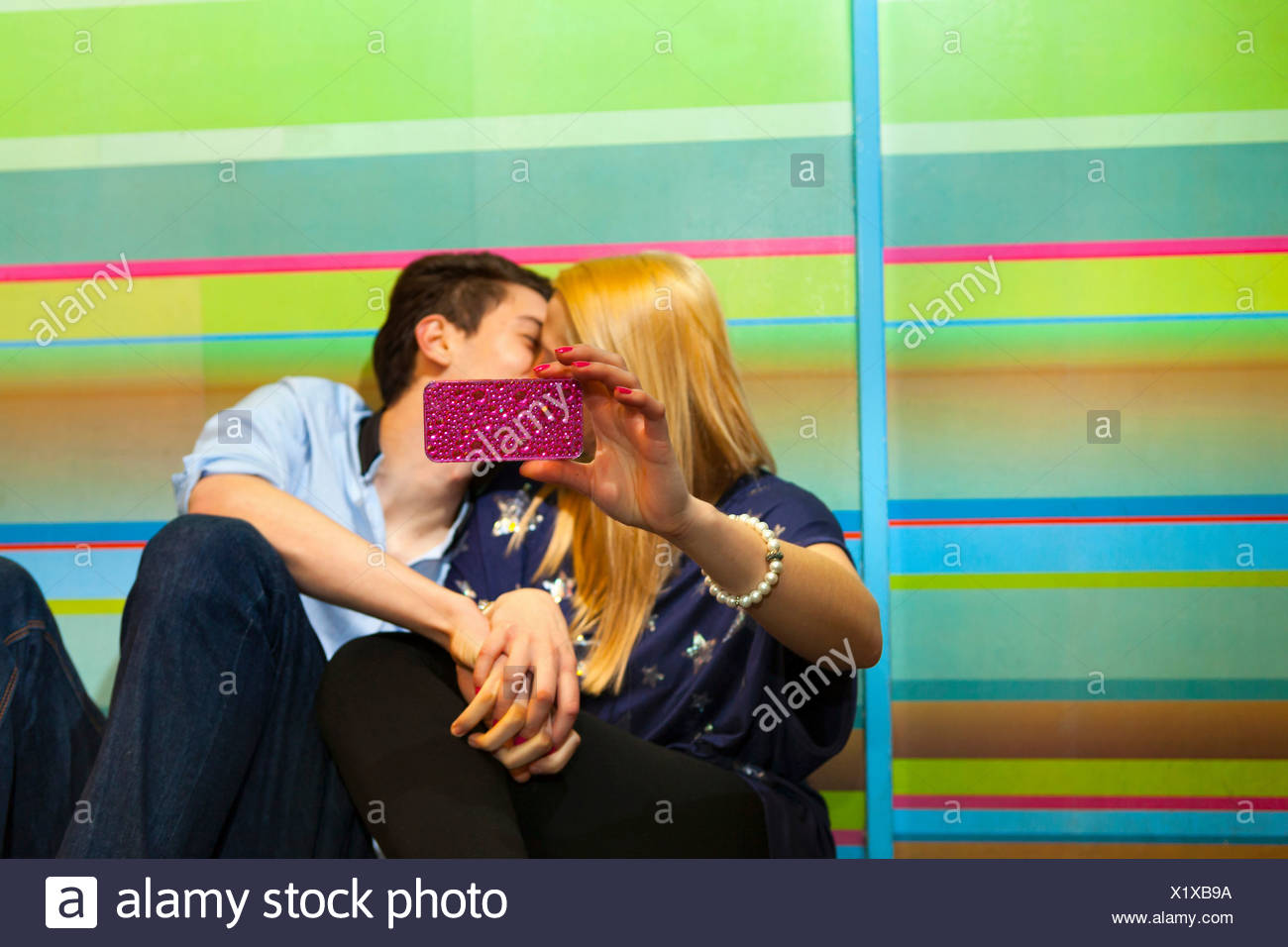 Young couple taking self portrait photograph of kiss Stock Photo