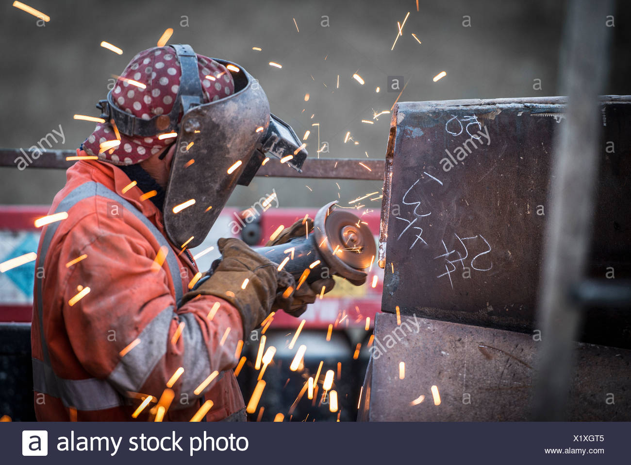 Metal grinding in repair works in surface coal mine - Stock Image