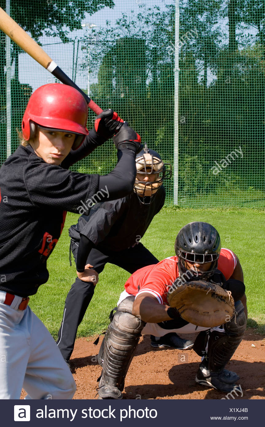 A baseball batter in front of a baseball catcher and umpire Stock Photo