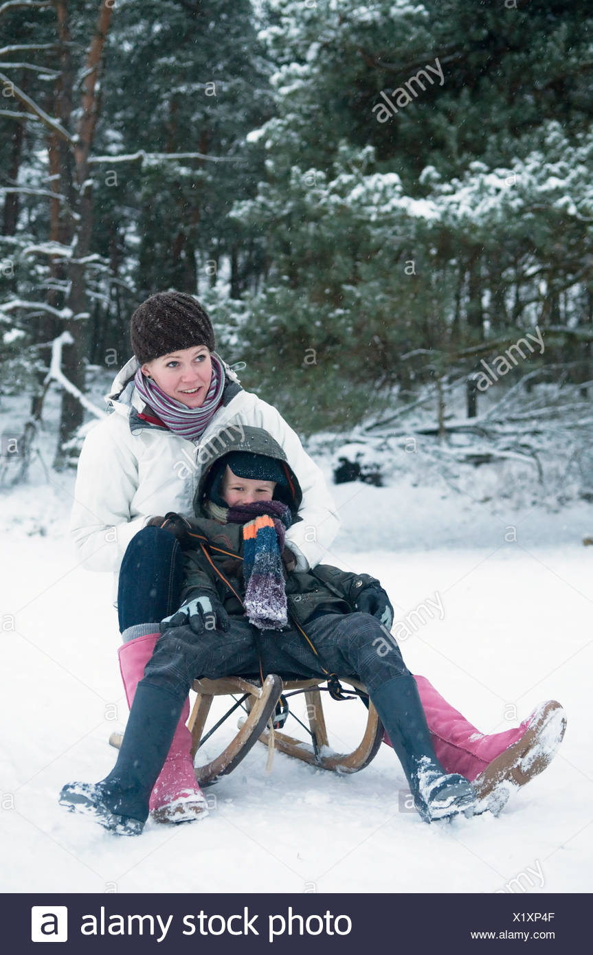 Boy and girl on a sled - Stock Image