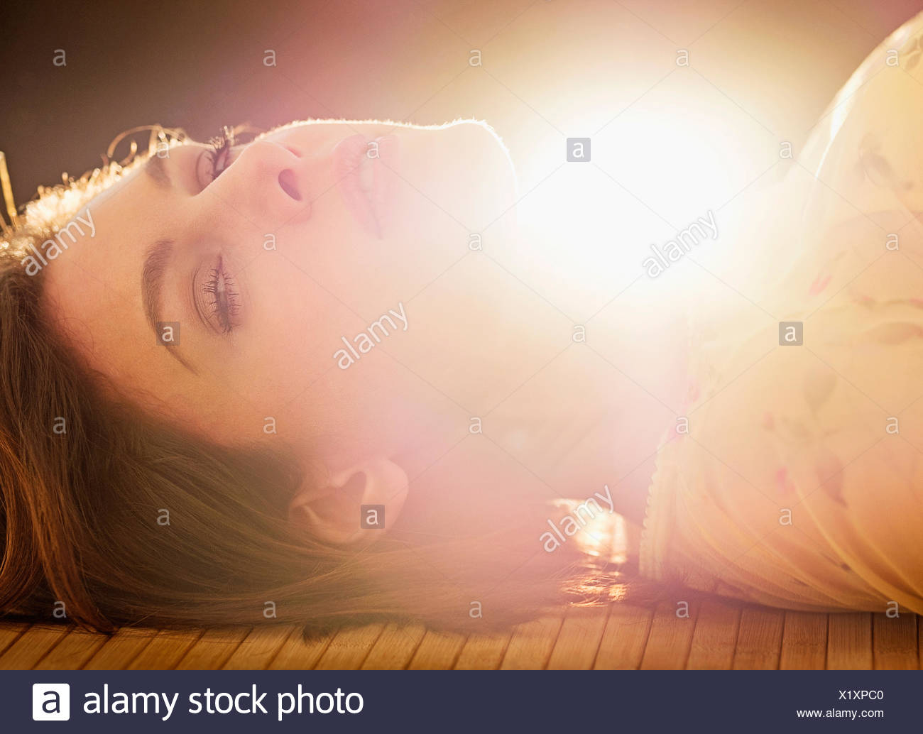 Portrait of beautiful woman with brown hair - Stock Image