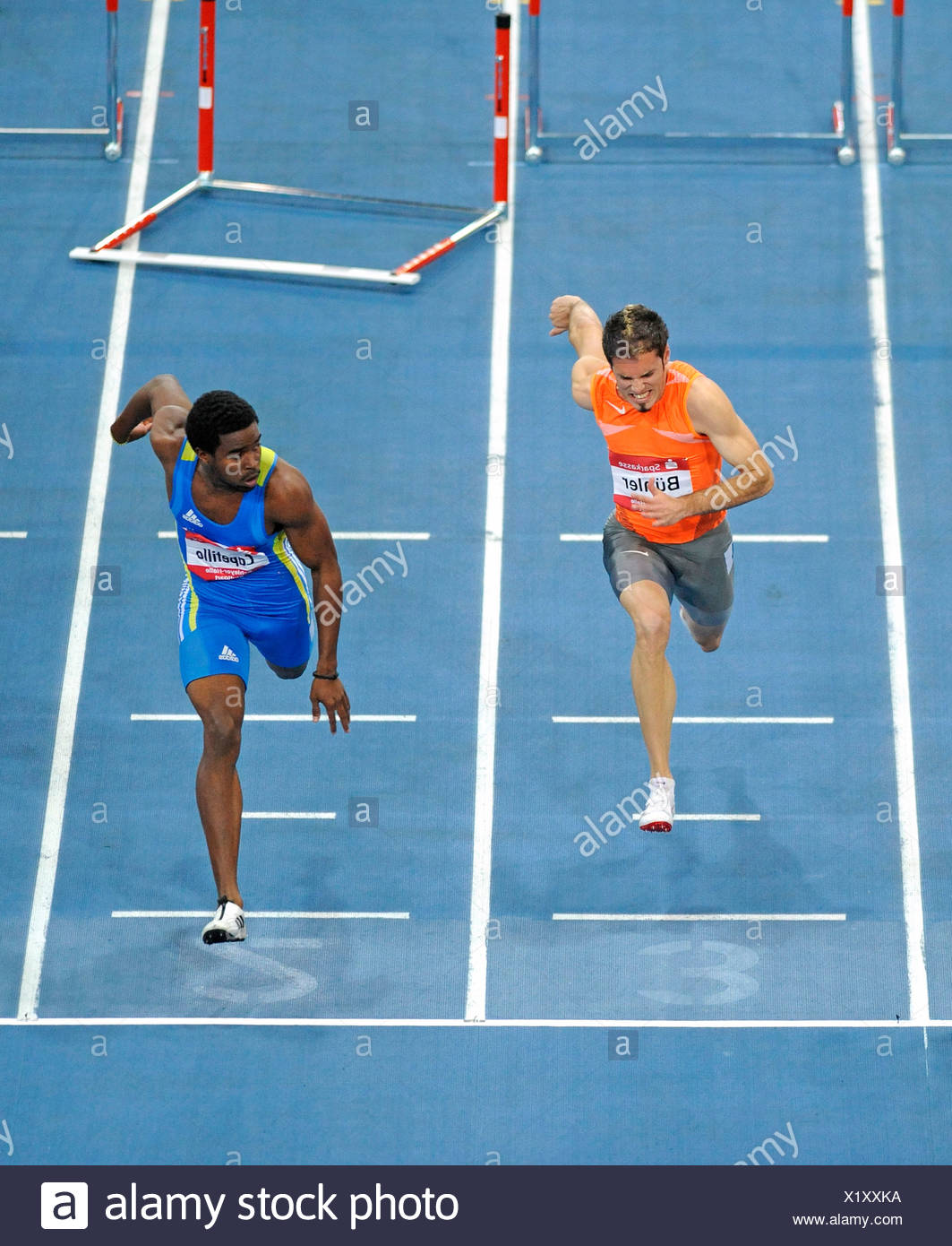 Men's Hurdles, finish, left to right: Matthias BUEHLER, GER, Dayron Capetillo, CUB, Sparkassen-Cup 2010 tournament, Hanns-Marti - Stock Image
