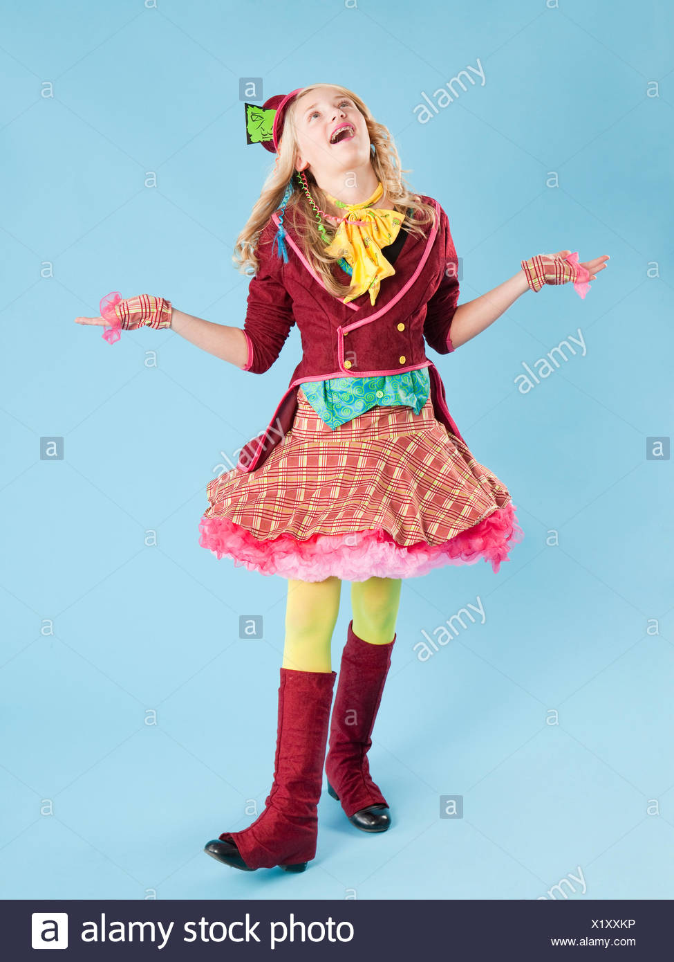 Girl (10-11) in Mad Hatter costume for Halloween - Stock Image