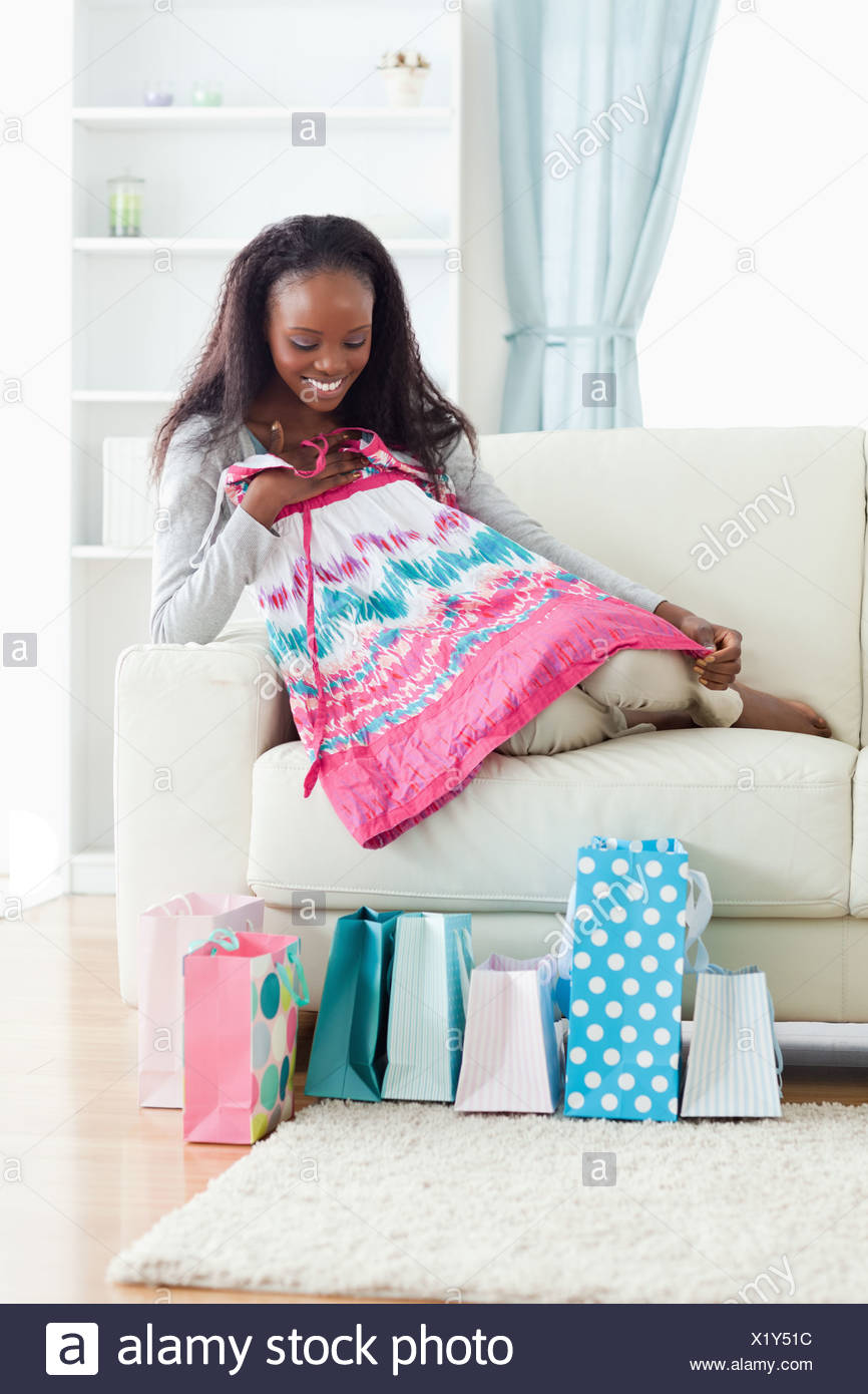 Woman taking a closer look at her shopping - Stock Image