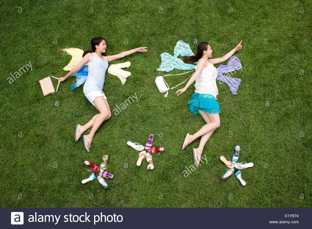 Creative young women imitating Fairy on meadow - Stock Image
