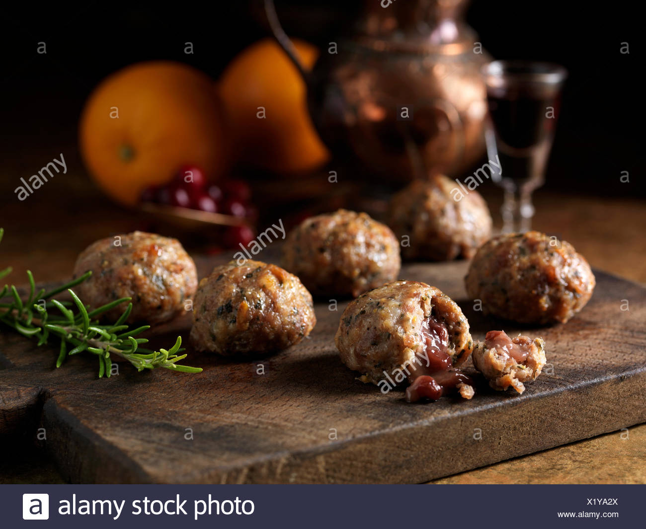Christmas ingredients of pork orange rosemary stuffing balls with port cranberry sauce centres Oranges a glass of red wine - Stock Image