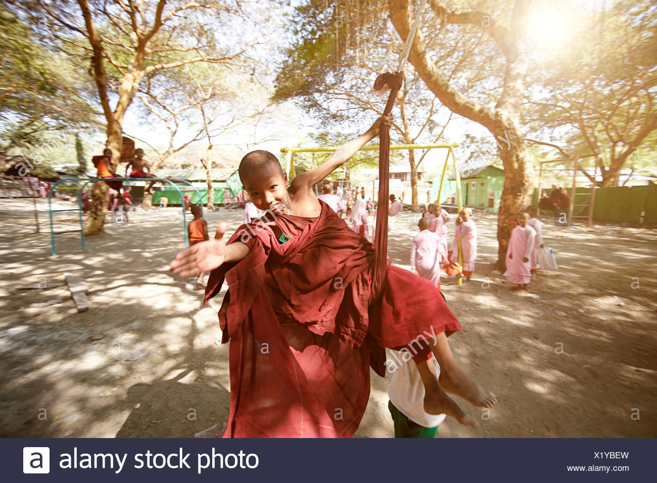 Students in the monk school are playing in the school yard - Stock Image