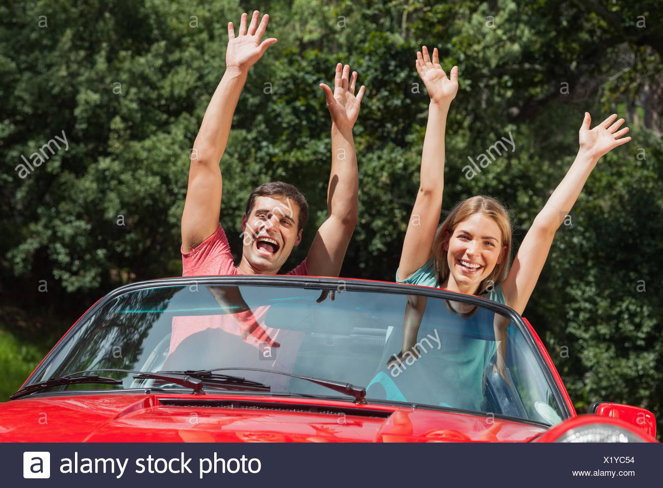 Happy couple having fun in their cabriolet - Stock Image