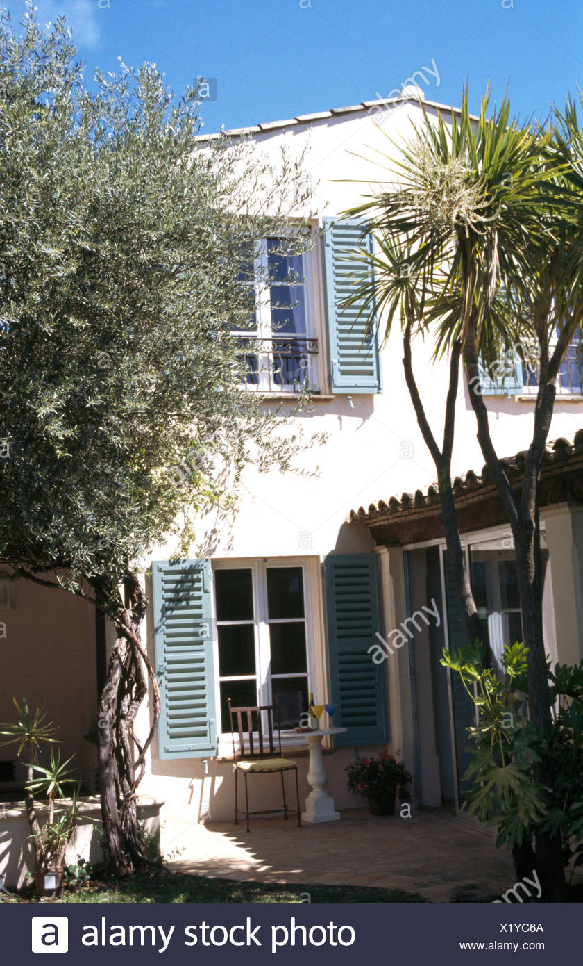 Exterior Of French Country House With Pale Blue Shutters