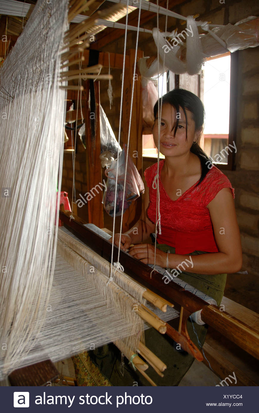 Handicraft, young woman weaving silk on a loom, Phonsavan, Xieng Khuang Province, Laos, Southeast Asia - Stock Image