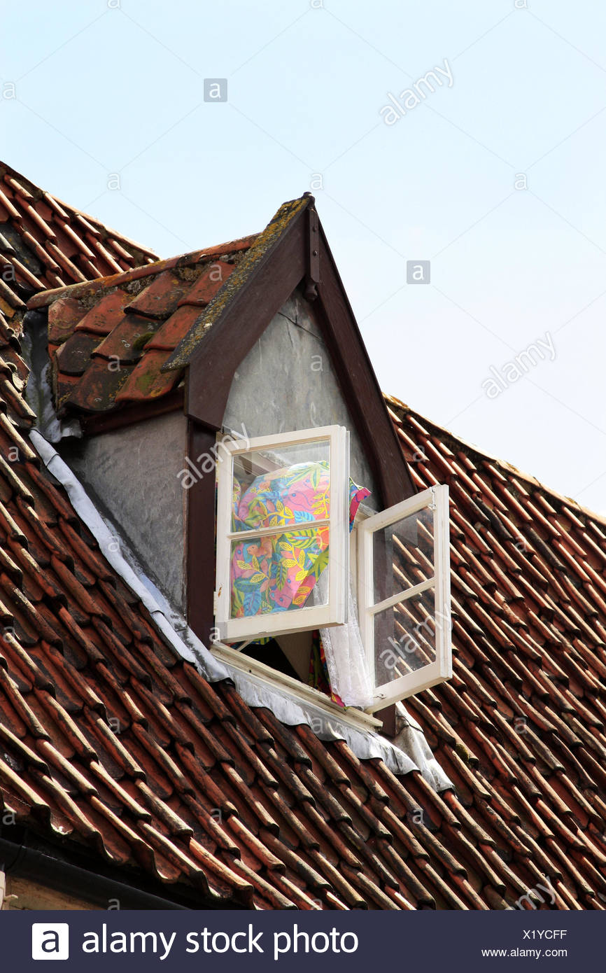 House roof, dormer, window, open, curtain, blowing, house, attic flat, attic, roof, wooden window, opened, air, outdoors, - Stock Image