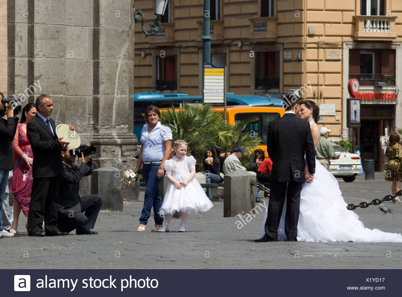 Bride and groom being photographed by their video and stills photographer on the Piazza Plebescito in front of the Palazzo Real - Stock Image