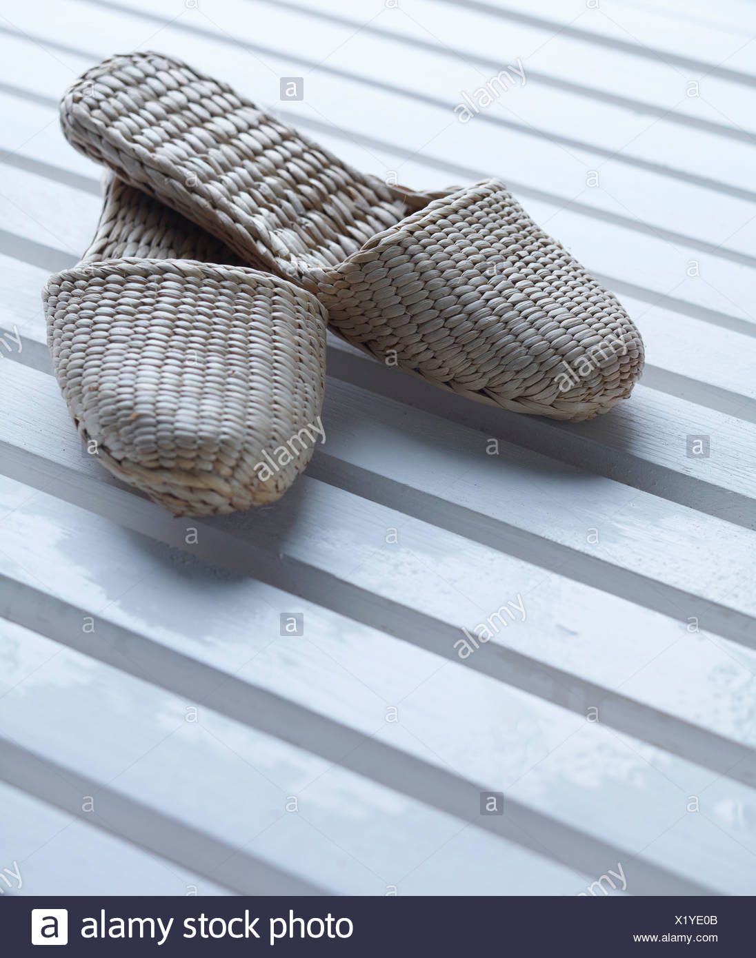 Close up of woven slippers - Stock Image