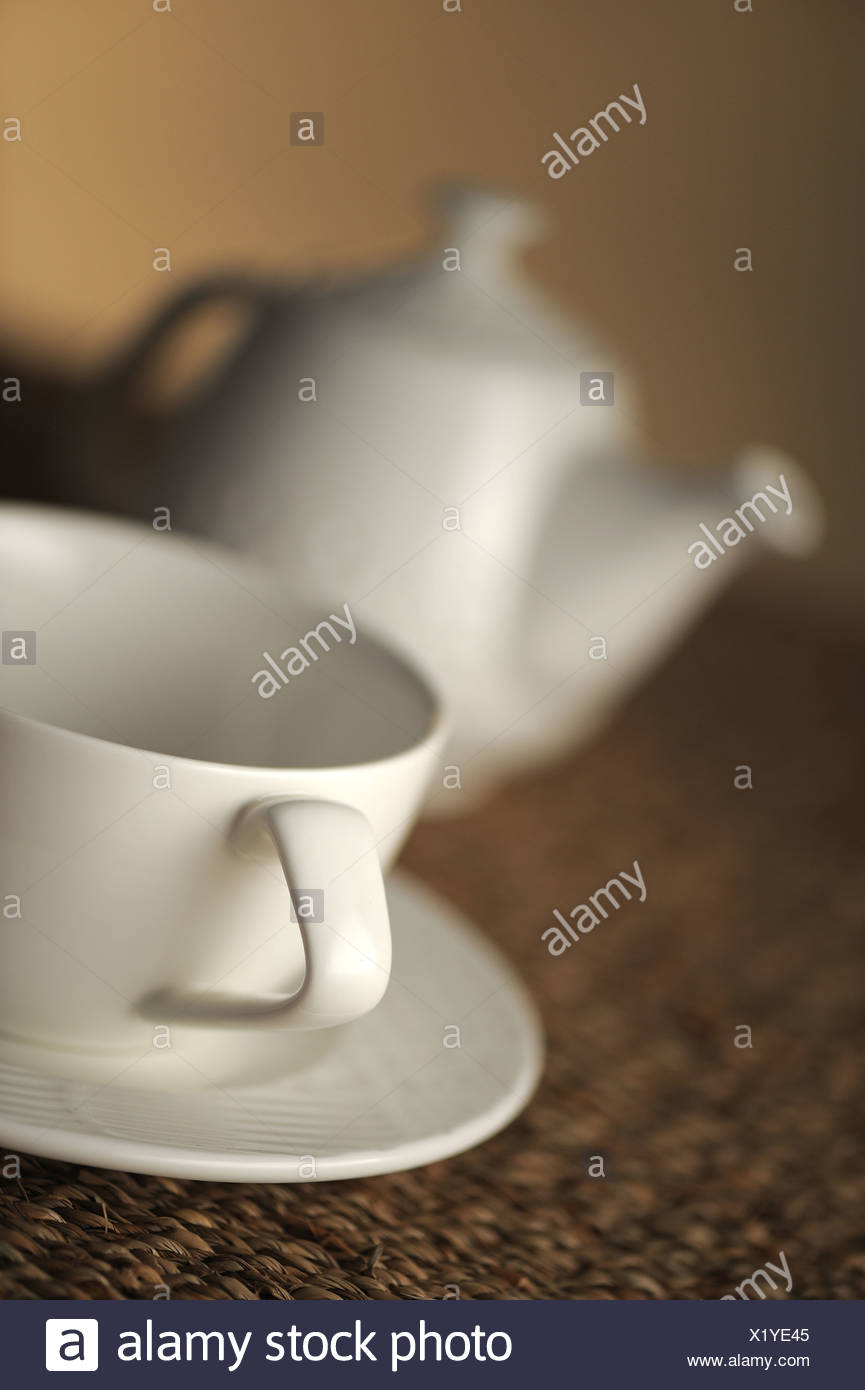 teapot on table, close up, shallow dof - Stock Image