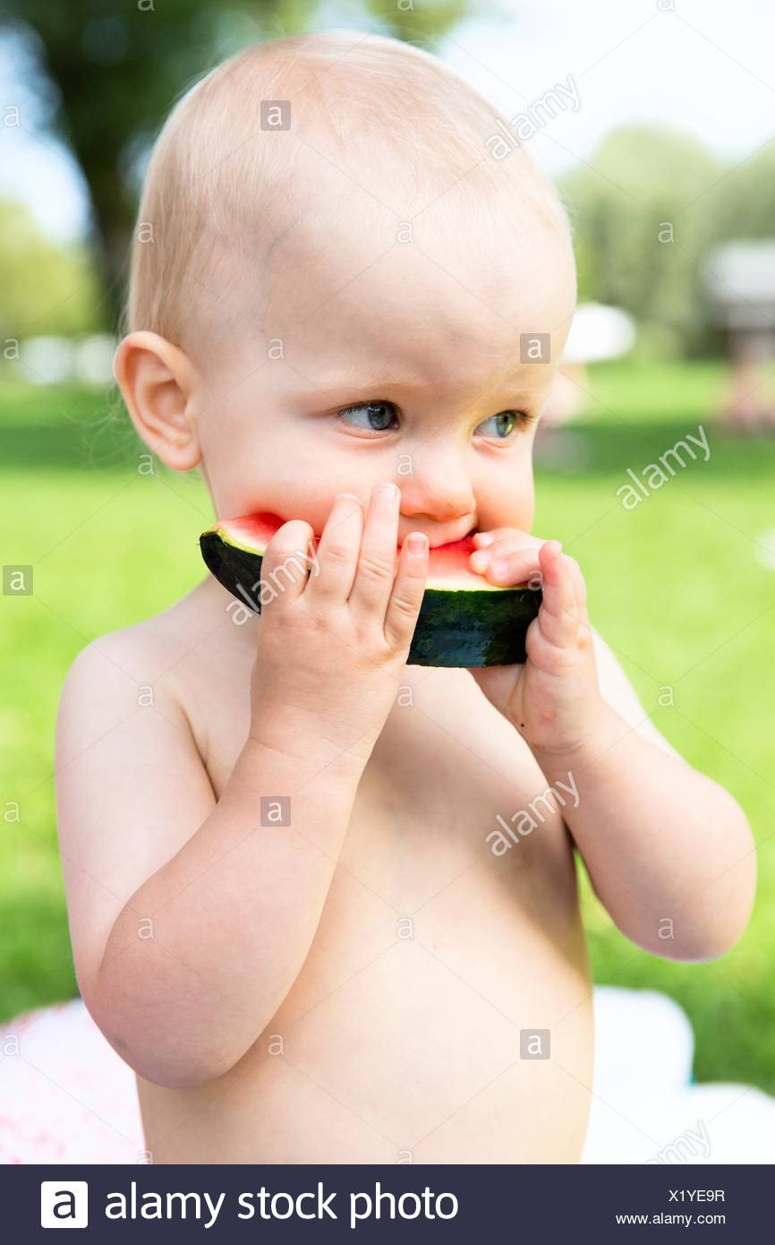 Baby, 12-14 months, eating watermelon Stock Photo
