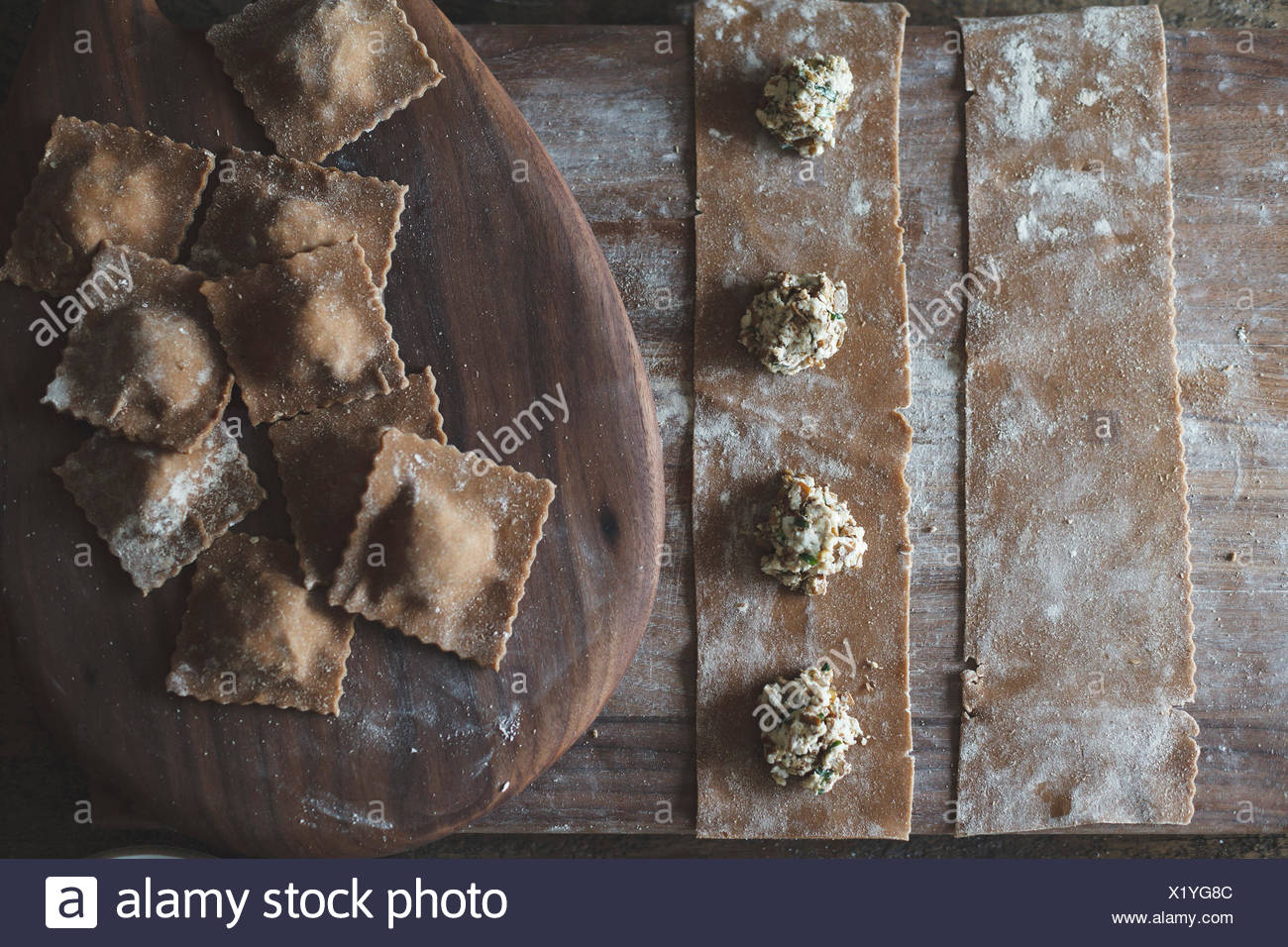 The cooking of chestnut flour ravioli with artichokes, peas and enoki mushrooms. - Stock Image