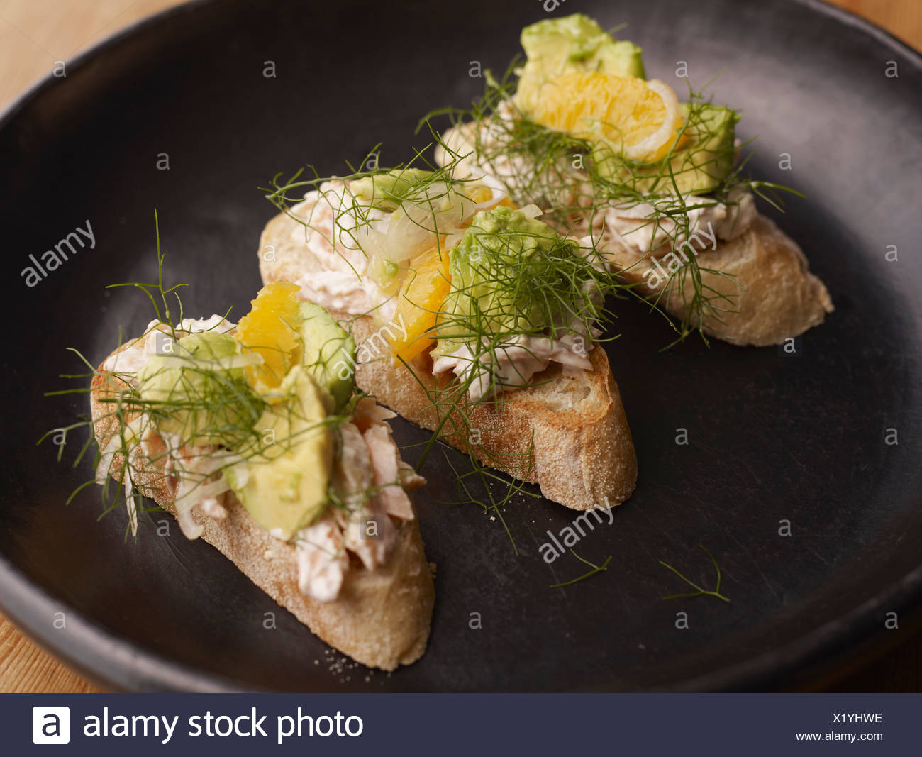 Smoked trout toasts with relish - Stock Image
