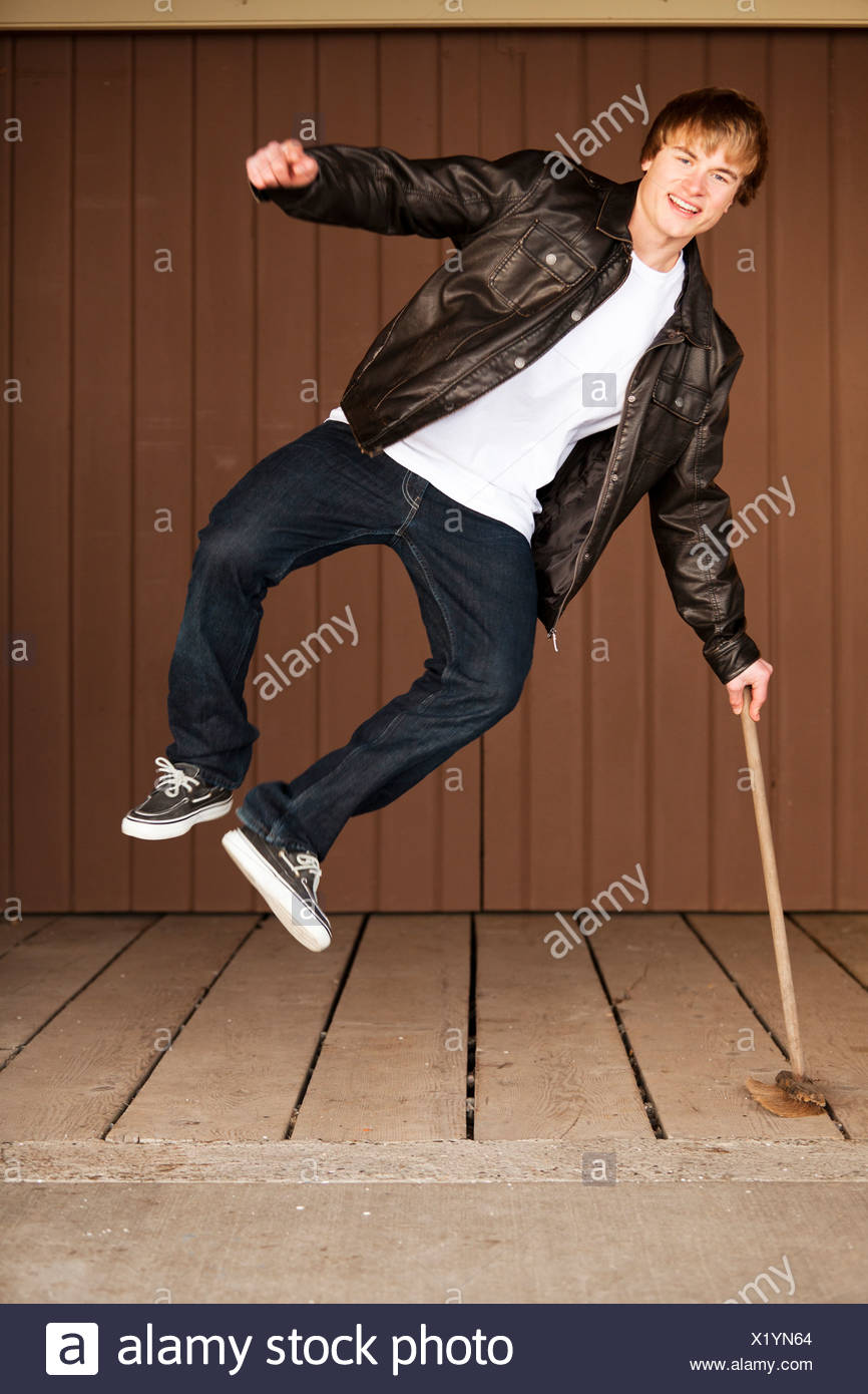 A man clicks his heels in the air. - Stock Image