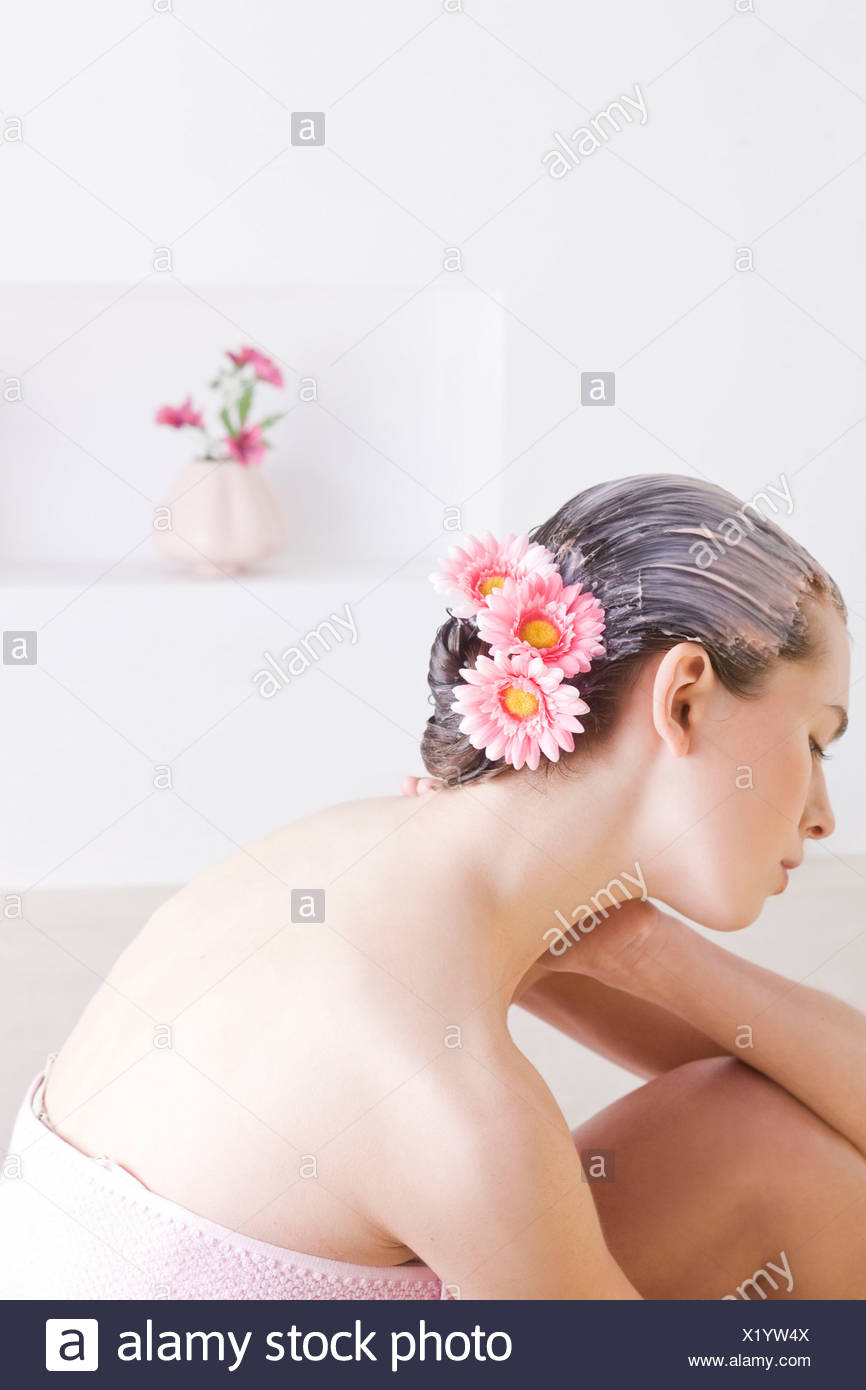 Woman with natural hair conditioner - Stock Image