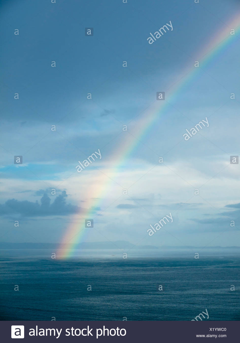 Southern Italy, Amalfi Coast, Piano di Sorrento, View of beautiful rainbow in sea at dawn - Stock Image
