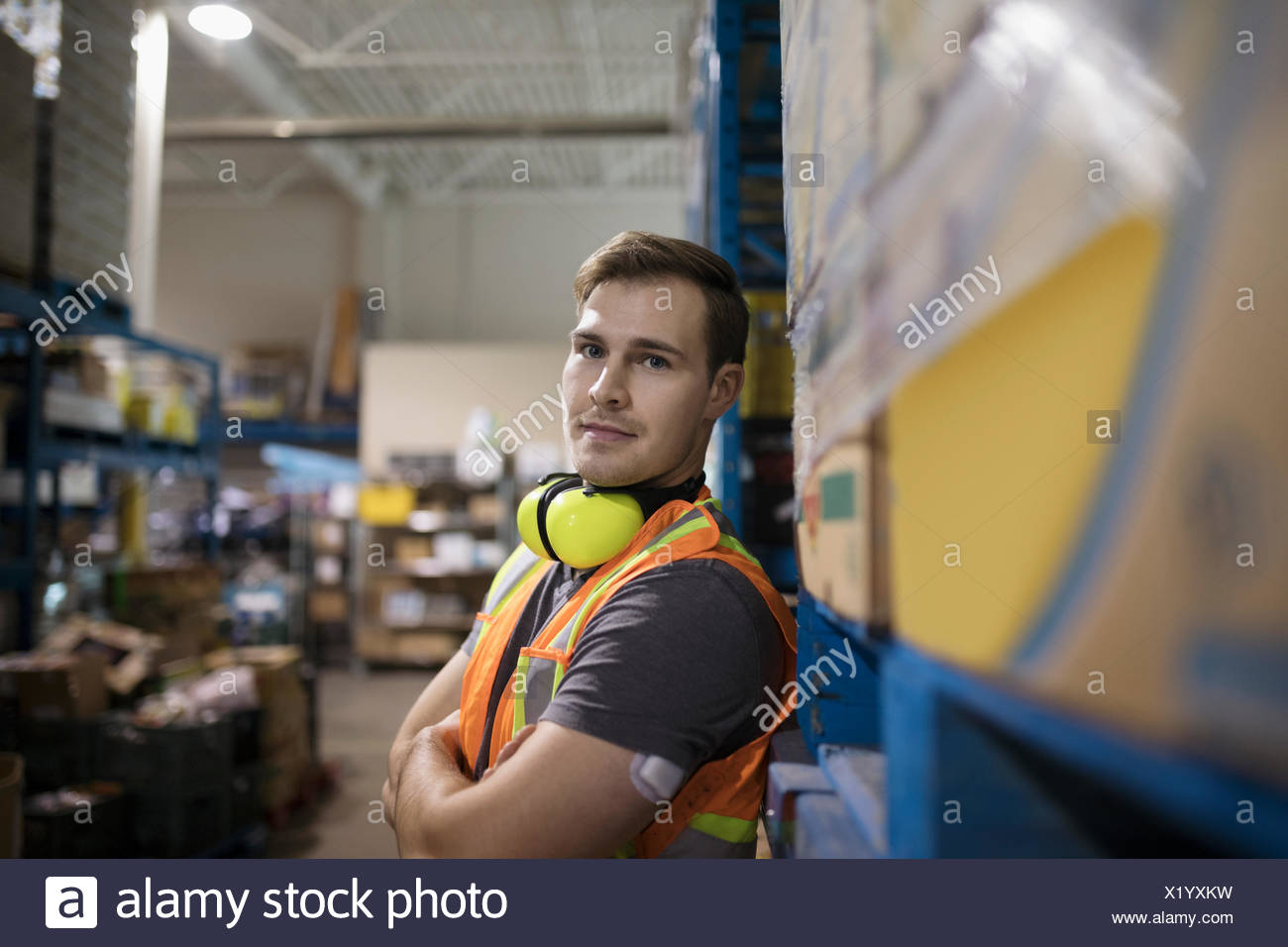Portrait confident male worker in distribution warehouse - Stock Image